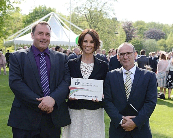 Principal Mr Griffin and DofE Co-ordinator Mr Duckworth receiving their DofE Licensed Organisation plaque from Andrea McLean, as a thank you from the DofE Charity for delivering the DofE during the Charity's Diamond Anniversary year.